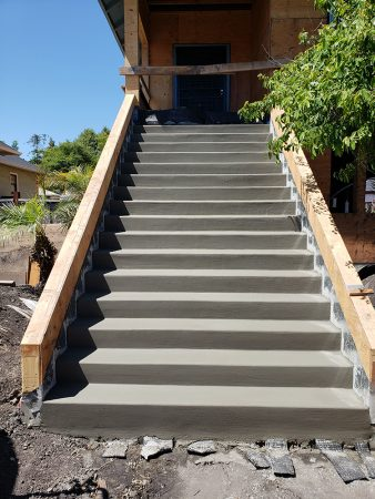 New concrete front staircase